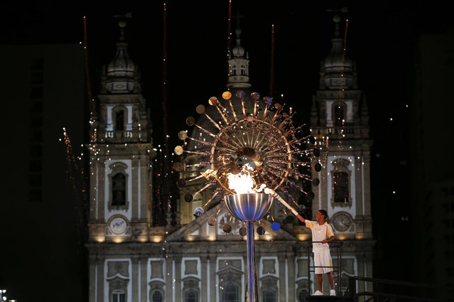 Jorge Alberto Oliveira Gomes lights the Olympic cauldron during the opening ceremony of the 2016 Summer Olympics in Rio de Janeiro, Brazil, Saturday, August 6, 2016. (Photo by Natacha Pisarenko/AP Photo)