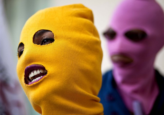 Masked women shout slogans during a demonstration marking the Latin American Day for Decriminalization of Therapeutic Abortion in Managua, Nicaragua, where abortions are illegal, on September 28, 2012. (Photo by Esteban Felix/Associated Press)