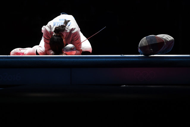 Russia's Yana Egorian celebrates winning against Russia's Sofya Velikaya in winning their women's individual sabre gold medal bout as part of the fencing event of the Rio 2016 Olympic Games, on August 8, 2016, at the Carioca Arena 3, in Rio de Janeiro. (Photo by Kirill Kudryavtsev/AFP Photo)