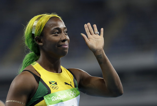 Jamaica's Shelly-Ann Fraser-Pryce waves after winning a women's 100-meter heat during the athletics competitions of the 2016 Summer Olympics at the Olympic stadium in Rio de Janeiro, Brazil, Friday, August 12, 2016. (Photo by David J. Phillip/AP Photo)