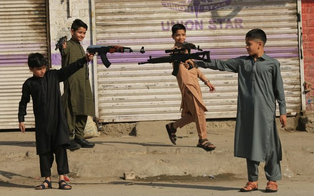 Children play with toy guns during Eid al-Fitr celebrations in Peshawar, Pakistan, 24 May 2020. Muslims around the world are celebrating Eid al-Fitr, the three day festival marking the end of the Muslim holy fasting month of Ramadan. Eid al-Fitr is one of the two major holidays in Islam. (Photo by Bilawal Arbab/EPA/EFE/Rex Features/Shutterstock)