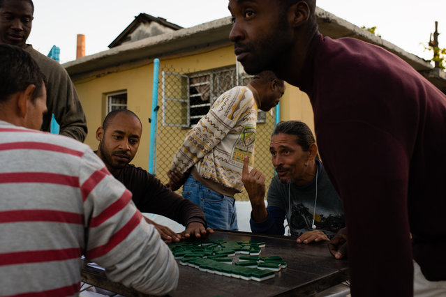 A group of men play dominos in the Verdado neighborhood of Havana, Cuba on January 28, 2015. The group of friends have been playing together about three times a week for the past 25 years. (Photo by Sarah L. Voisin/The Washington Post)