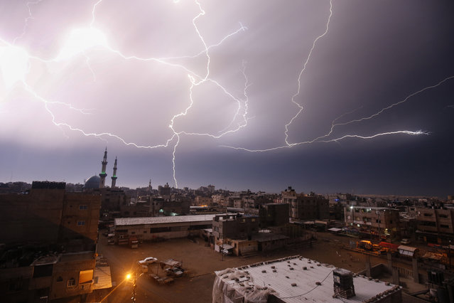 A picture taken on January 16, 2020 shows lightnings over Rafah in the southern Gaza Strip during heavy rains. (Photo by Said Khatib/AFP Photo)