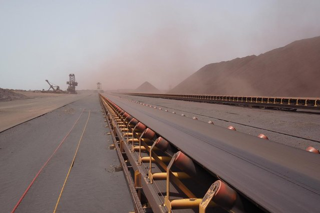 A conveyor belt used to transport iron ore to a ship is seen at SNIM headquarters in the port of Nouadhibou June 26, 2014. (Photo by Joe Penney/Reuters)