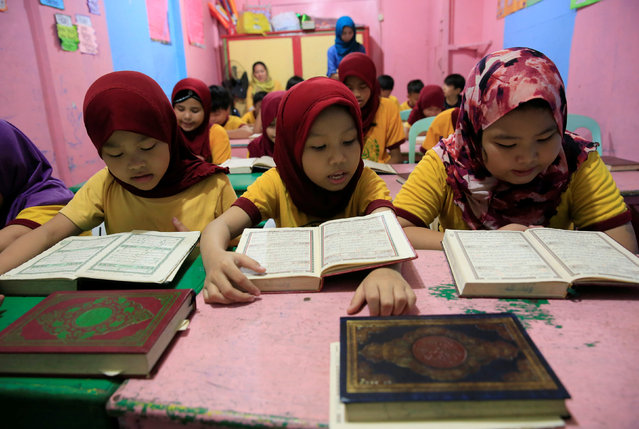 Muslim children read the Koran as they study inside a school in Taguig city, metro Manila, Philippines September 9, 2016, ahead of Eid Al-Adha. (Photo by Romeo Ranoco/Reuters)