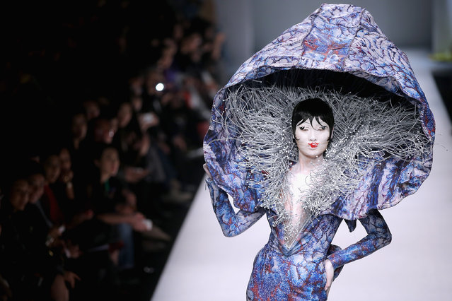 A model showcases designs on the runway at Hu Sheguang Collection show during Mercedes-Benz China Fashion Week Spring/Summer 2015 at Beijing Hotel on October 31, 2014 in Beijing, China. (Photo by Feng Li/Getty Images)