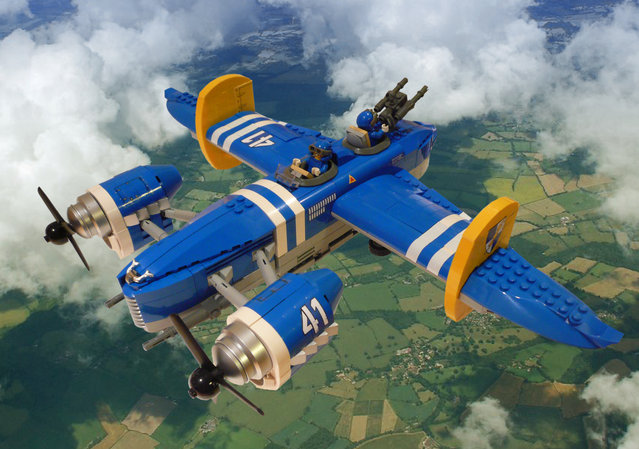 """""""Blue Lightning. The H-44 tactical bomber of the Heliconian Royal Air Force nicknamed the """"Blue Lightning"""" for its speed and ability to inflict massive damage on the ground"""". (Jon Hall)"""