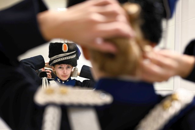Members of the Royal Netherlands Marechaussee put on their ceremonial uniform at the Queen Beatrix Barracks in preparation for Prinsjesdag in The Hague, The Netherlands, 15 September 2020. Because of the coronavirus crisis, Prinsjesdag looks different than usual. Many of the ceremonial events are canceled. (Photo by Frank van Beek/EPA/EFE)