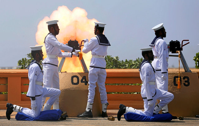 Sri Lanka's navy fires a gun salute during the Sri Lanka's 70th Independence day celebrations in Colombo, Sri Lanka February 4, 2018. (Photo by Dinuka Liyanawatte/Reuters)