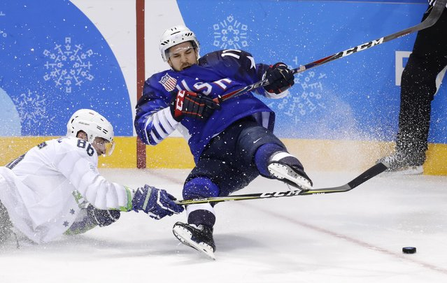 Slovenia's Sabahudin Kovacevic falls in the men's preliminary round ice hockey match between the US and Slovenia during the Pyeongchang 2018 Winter Olympic Games at the Kwandong Hockey Centre in Gangneung on February 14, 2018. (Photo by David W. Cerny/Reuters)