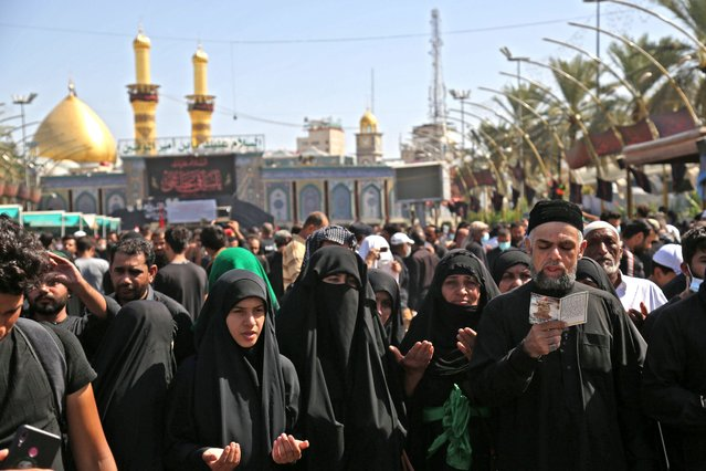 Shiite Muslims take part in a mourning ritual in Iraq's central holy city of Karbala, on October 8, 2020, a day ahead of Arbaeen, which marks the end of the 40-day mourning period for the seventh century killing of Imam Hussein, Prophet Mohammed's grandson. (Photo by Mohammed Sawaf/AFP Photo)