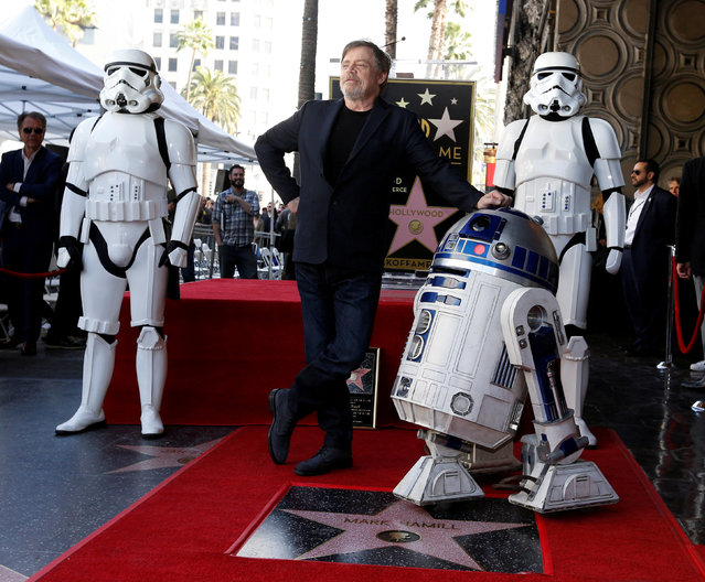 """Actor Mark Hamill poses with """"Star Wars"""" characters R2-D2 and Stormtroopers after unveiling his star on the Hollywood Walk of Fame in Los Angeles, California, U.S., March 8, 2018. (Photo by Mario Anzuoni/Reuters)"""