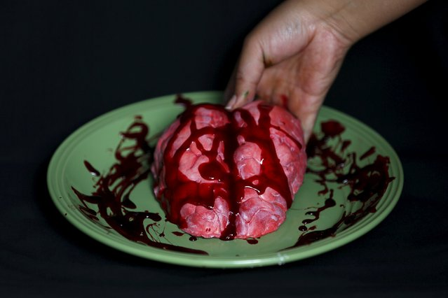 A bloody brain made of gummy candy and red jelly is pictured at the Zombie Gourmet homemade candy manufacturer on the outskirts of Mexico City October 30, 2015. (Photo by Carlos Jasso/Reuters)