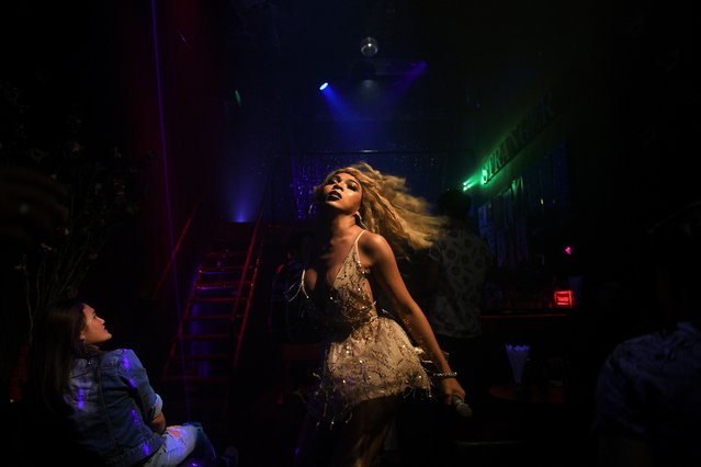 Transgender drag queen Aunchalee Pokinwuttipob, better known by the stage name, Angele Anang, 26, performs at The Stranger bar in Bangkok, Thailand, September 18, 2020. (Photo by Chalinee Thirasupa/Reuters)