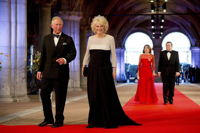 Britain's Prince Charles (L) and his wife Camilla, Duchess of Cornwall, arrive at a gala dinner organised on the eve of the abdication of Queen Beatrix of the Netherlands and the inauguration of her successor King Willem-Alexander at the Rijksmuseum in Amsterdam April 29, 2013. (Photo by Robin Utrecht/Reuters)