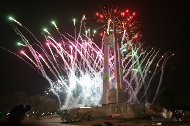 Fireworks begin during a New Year's eve countdown at the Quezon Memorial Circle in suburban Quezon city, north of Manila, Philippines on Wednesday, December 31, 2014. (Photo by Aaron Favila/AP Photo)