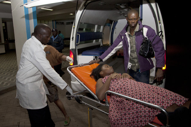 A survivor of a multi-storey building collapse arrives for treatment at Kenyatta National Hospital in the capital Nairobi, Kenya Sunday, January 4, 2015. (Photo by Sayyid Azim/AP Photo)