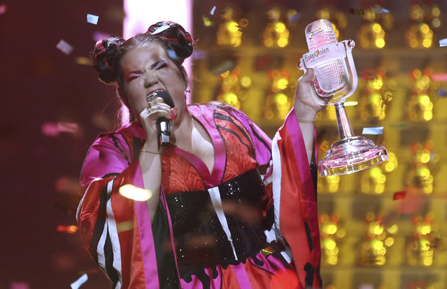 Netta from Israel celebrates after winning the Eurovision song contest in Lisbon, Portugal, Saturday, May 12, 2018 during the Eurovision Song Contest grand final. (Photo by Armando Franca/AP Photo)