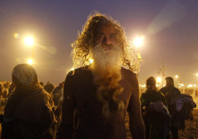 A Sadhu or a Hindu holyman arrives to take a holy dip at Sangam during Magh Mela in the northern Indian city of Allahabad January 5, 2015. The festival is an annual religious event held during the Hindu month of Magh, when thousands of devotees take a holy dip in the waters of Sangam, the confluence of the Ganges, Yamuna and Saraswati rivers. (Photo by Jitendra Prakash/Reuters)
