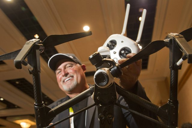 Randy Braun holds a DJI Inspire 1 flying platform during the 2015 International Consumer Electronics Show (CES) in Las Vegas, Nevada January 4, 2015. The remote control quadcopter, with 4K video camera and three-axis gimbal, is a sophisticated filmmaking system straight from the box, said Braun. The system retails for $2,890.00, he said. (Photo by Steve Marcus/Reuters)