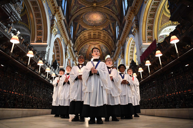 Choristers sing during a photo call as the St Paul's Cathedral Choristers prepare for their first livestreamed Christmas concert at St Paul's Cathedral in London on December 14, 2020. Due to Covid-19 pandemic restrictions on numbers of visitors to the Cathedral St Paul's is livestreamning their Christmas concerts for the first time. (Photo by Daniel Leal-Olivas/AFP Photo)