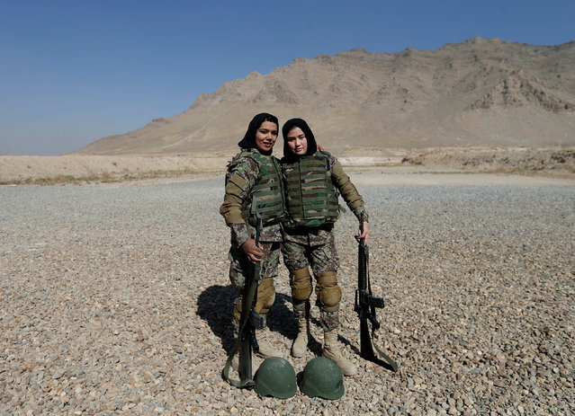Female soldiers Mohazama Najebi, 18 (R), and Sahar Ibrahimi, 25 (L), from the Afghan National Army (ANA) pose for a picture after shooting exercises at the Kabul Military Training Centre (KMTC) in Kabul, Afghanistan October 26, 2016. (Photo by Mohammad Ismail/Reuters)