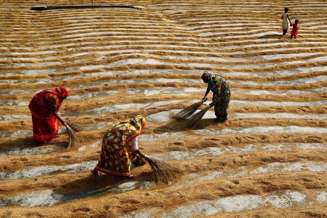 Women work in a rice processing mill in Munshiganj, Bangladesh on January 4, 2021. (Photo by Mohammad Ponir Hossain/Reuters)