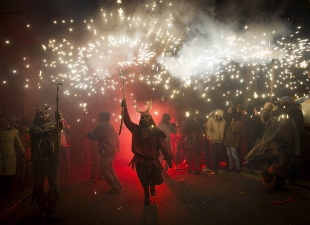 """A reveller wearing a demon costume takes part in the traditional festival of """"Correfoc"""" in Palma de Mallorca, on January 17, 2015. (Photo by Jaime Reina/AFP Photo)"""
