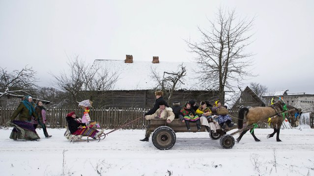 Villagers take part in Kolyada holiday celebrations in the village of Martsiyanauka, east of the capital Minsk, January 21, 2015. (Photo by Vasily Fedosenko/Reuters)