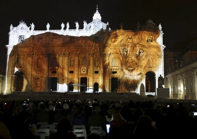 """A picture of a lion, part of an art projection featuring images of humanity and climate change artistically rendered by Obscura Digital, is projected onto the facade of St. Peter's Basilica, as part of an installation entitled """"Fiat Lux: Illuminating our Common Home"""" as a gift to Pope Francis on the opening day of the Extraordinary Jubilee, at the Vatican, December 8, 2015. (Photo by Stefano Rellandini/Reuters)"""