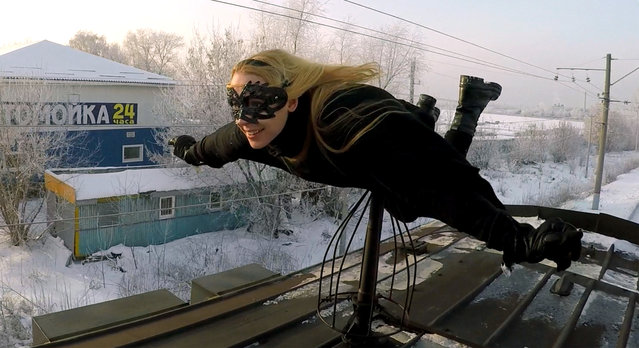 Rush-hour in Russia means one thing for this daredevil: train surfing! The 19-year-old daredevil who goes by the name Kobzarro started train surfing aged 15 as a way of escaping an oppressive family life. Here Kobzarro can be seen balanced on top of a train as it speeds through the wintery Russian environment. (Photo by Caters News Agency)
