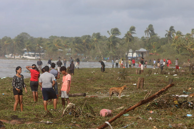 Locals look at damages caused by the passage of Hurricane Eta in Puerto Cabezas, Nicaragua, on November 4, 2020. Hurricane Eta slowed to tropical storm speeds on Wednesday morning even as it pummeled Nicaragua, killing two people there and one in neighboring Honduras, while unleashing fierce winds and heavy downpours. (Photo by Inti Ocon/AFP Photo)