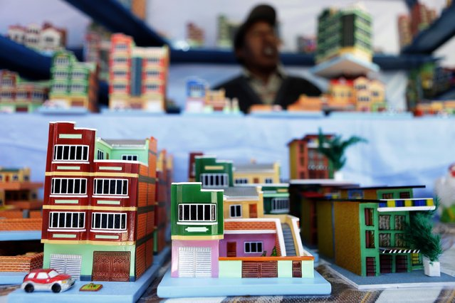 "Miniature houses are displayed during the ""Alasitas"" fair in La Paz January 24, 2015. (Photo by David Mercado/Reuters)"