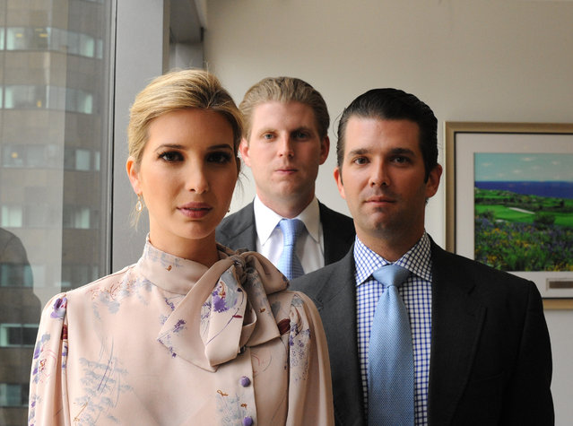 Siblings Ivanka, Eric, with blond hair, in white shirt and blue tie, and Donald Trump, Jr. are seen together in Trump Tower in Manhattan, NY on June 6, 2012. (Photo by Jennifer S. Altman/The Washington Post)
