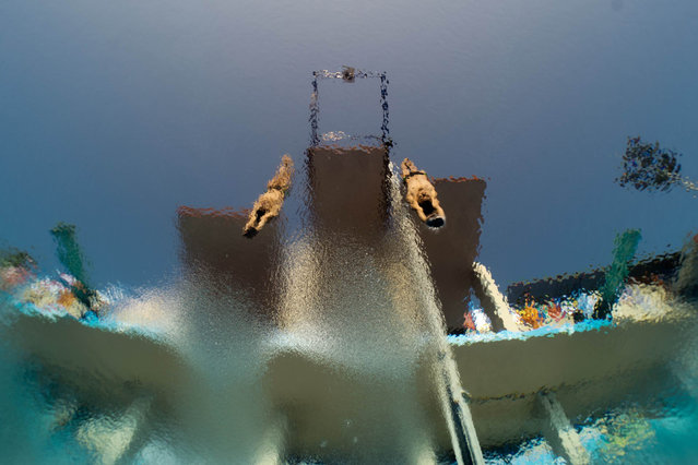 In a picture taken with an underwater camera Mexico's Ivan Garcia and German Sanchez compete in the men's 10-metre synchro platform preliminary diving event in the FINA World Championships at the Piscina Municipal de Montjuic in Barcelona on July 21, 2013. (Photo by Francois Xavier Marit/AFP Photo)