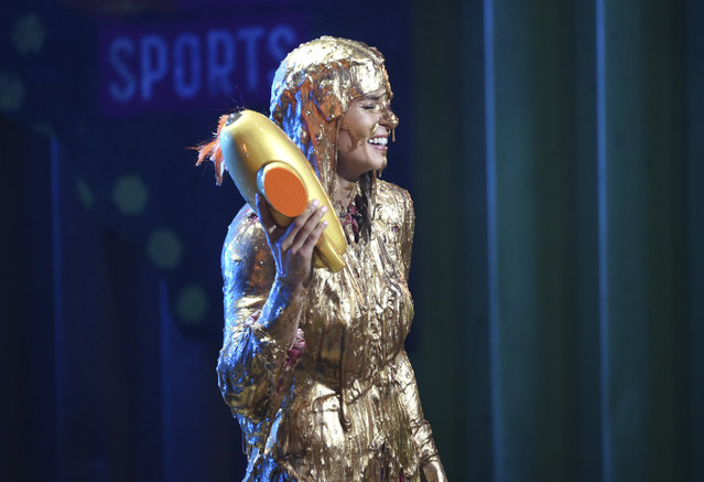Former NASCAR driver Danica Patrick gets slimed after receiving the legend award at the Kids' Choice Sports Awards at the Barker Hangar on Thursday, July 19, 2018, in Santa Monica, Calif. (Photo by Phil McCarten/Invision/AP Photo)
