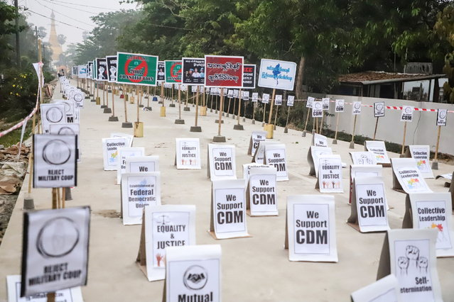 View of signs during a protest without demonstrators present in Nyaungdon, Ayeyarwady, Myanmar on March 14, 2021 in this image taken from social media. (Photo by Ayeyarwaddy Karen Youth Seminar via Reuters)
