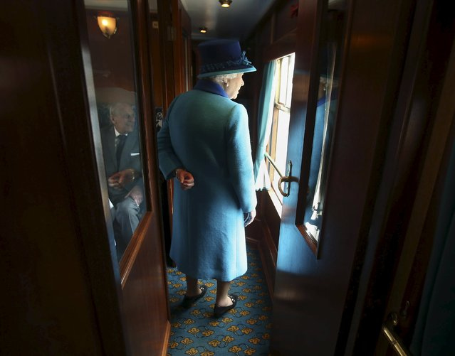 Britain's Queen Elizabeth boards her carriage as she travels on the new Scottish Borders railway line, in Scotland, Britain September 9, 2015. (Photo by Andrew Milligan/Reuters)