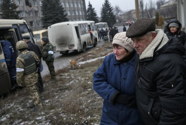 Local residents react as they watch their relatives board buses to flee the conflict in Debaltseve, eastern Ukraine, February 6, 2015. (Photo by Gleb Garanich/Reuters)