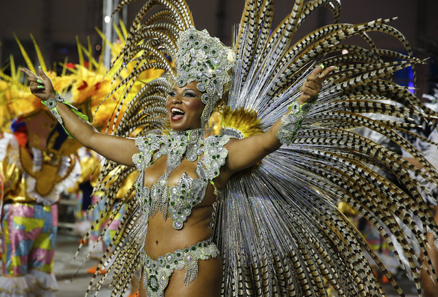 A dancer from the Academicos do Tucuruvi samba school performs during the Carnival parade at the Sambodromo in Sao Paulo, Brazil, Friday, February 13, 2015. (Photo by Andre Penner/AP Photo)