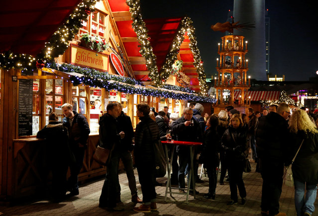 People visit the Christmas market near Alexanderplatz square in Berlin, Germany, November 23, 2016. (Photo by Fabrizio Bensch/Reuters)