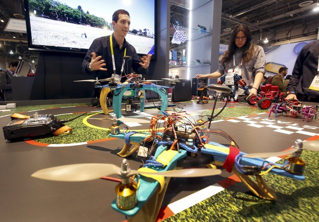 Kevin Lee, a project engineer with XYZ Printing, displays 3D-printed drones during the 2016 CES trade show in Las Vegas, Nevada January 8, 2016. The drones are part of the company's STREAM (Science, Technology, Engineering, Arts and Mathematics) program that provides 3D printing educational programs to educators. (Photo by Steve Marcus/Reuters)