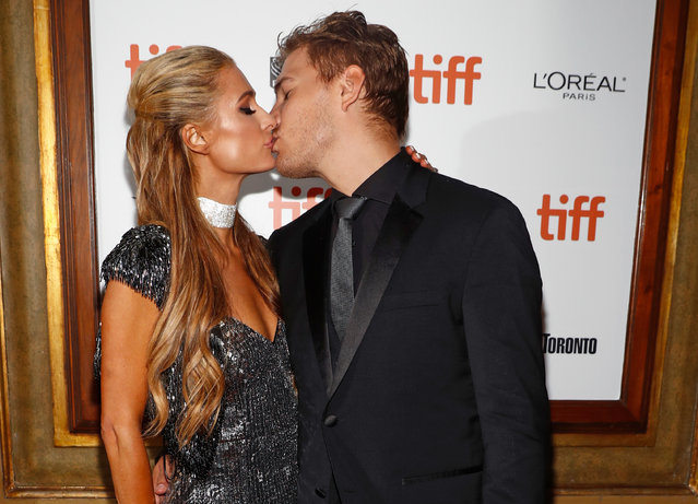 Actor Chris Zylka kisses his girlfriend Paris Hilton as he arrives for the world premiere of The Death and Life of John F. Donovan at the Toronto International Film Festival (TIFF) in Toronto on September 10, 2018. (Photo by Mark Blinch/Reuters)