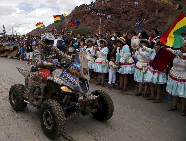 Alejandro Patronelli of Argentina rides his Yamaha quad past Bolivian women during the seventh stage in the Dakar Rally 2016 in Tupiza, Bolivia, January 9, 2016. (Photo by Marcos Brindicci/Reuters)