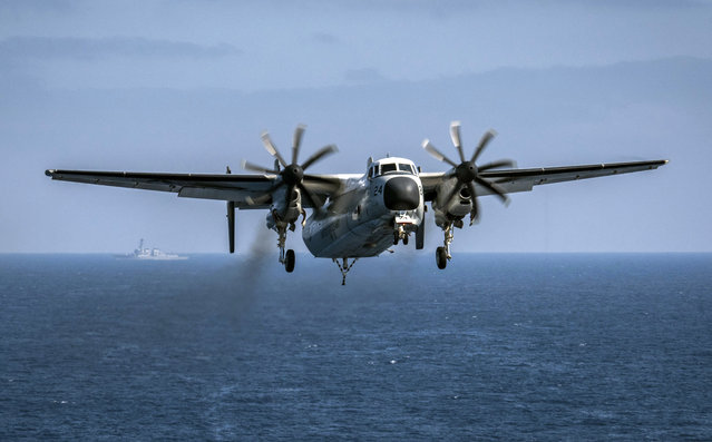 In this August 22, 2017, file photo provided by the U.S. Navy, a C-2A Greyhound assigned to the Providers of Fleet Logistics Support Squadron (VRC) 30, prepares to land on the flight deck aboard the aircraft carrier USS Theodore Roosevelt (CVN 71). The U.S. Navy has located a transport aircraft deep on the Pacific Ocean floor where it crashed in November, killing three sailors on board. The C-2A Greyhound aircraft, which was traveling to the aircraft carrier USS Ronald Reagan when it crashed the day before Thanksgiving in the Philippine Sea, rests at a depth of about 18,500 feet (5,640 meters), the Japan-based 7th Fleet said in a statement Saturday, Jan. 6, 2018. (Photo by Mass Communication Specialist 3rd Class Alex Corona/U.S. Navy via AP Photo)