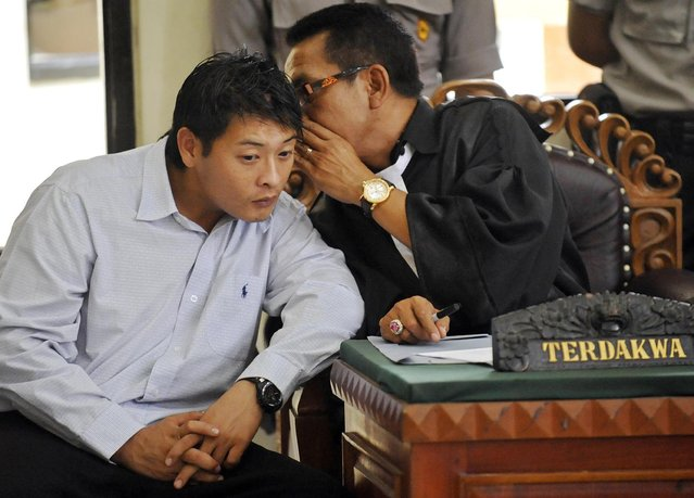 Death row prisoner Andrew Chan (L)  of Australia listens to his lawyer during a review hearing in the District Court of Denpasar on the Indonesian island of Bali, in this October 8, 2010 file picture. Two convicted Australian drug smugglers, Myuran Sukumaran, 33, and Andrew Chan, 31, were transferred on March 4, 2015, from a Bali prison to an island for execution along with other foreigners, underlining Indonesia's determination to use the death penalty despite international criticism.  Mandatory Credit. REUTERS/Nyoman Budhiana/Antara Foto/Files