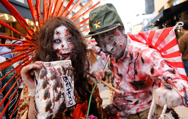 Participants in costumes pose during a Halloween event in Kawasaki, south of Tokyo, Japan on October 28, 2018. (Photo by Toru Hanai/Reuters)