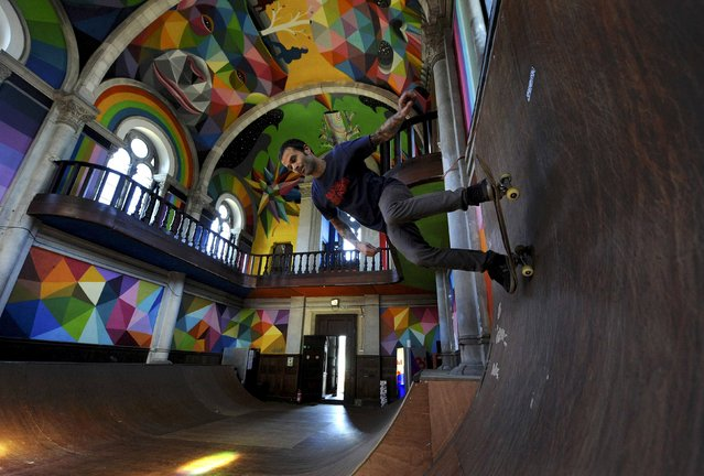 "A man practises skateboarding inside the desconsecrated Santa Barbara church, which was first started in 1913 and abandoned for decades, in Llanera, northern Spain, January 24, 2016. A collective of skaters named ""The Church Brigade"" is building a skate park inside the former place of worship, turning it into a place of pilgrimage for lovers of the activity. (Photo by Eloy Alonso/Reuters)"