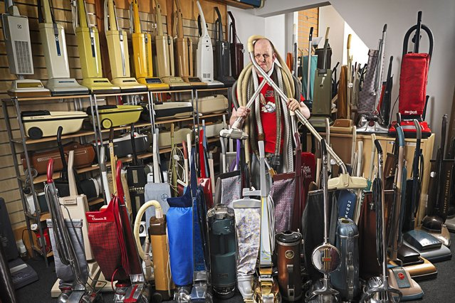 James Brown, 33, who has made it into the Guinness Book of World Records for owning the largest collection of vacuum cleaners, with 322 different models in his collection. (Photo by PA Wire)