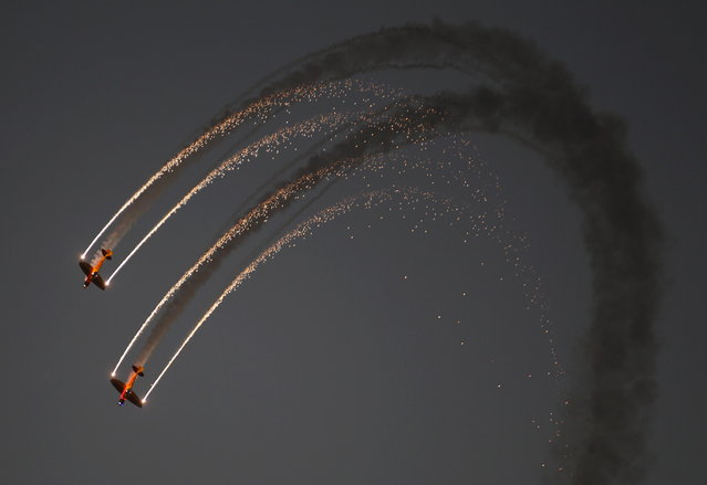 BAHRAIN: DHL's Twisters & Extra 300 perform during the second day of the Bahrain Air Show 2016 at Sakhir, south of Bahrain January 22, 2016. (Photo by Hamad I. Mohammed/Reuters)